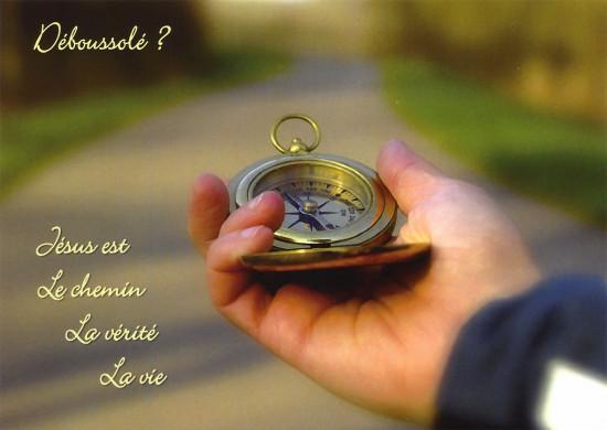 Carte avec Verset Boussole dans main