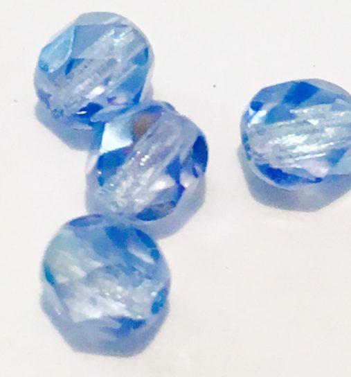 Perles demi-cristal ovales bleues 6 mm.130 perles