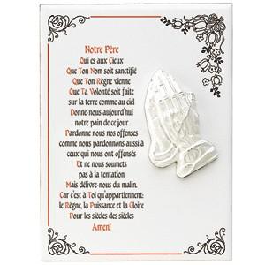 Céramique avec des mains en prière en relief
